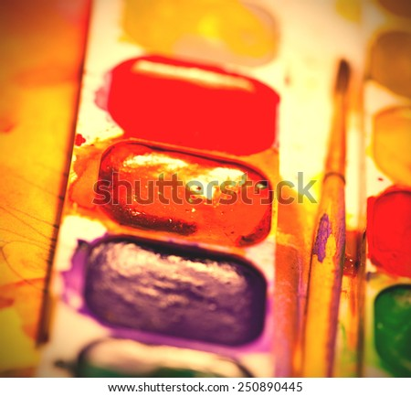 aquarelle paints with brush, shallow depth of field. instagram image style - stock photo
