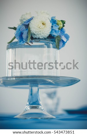 Aquarium decorated with flowers as wedding table decoration