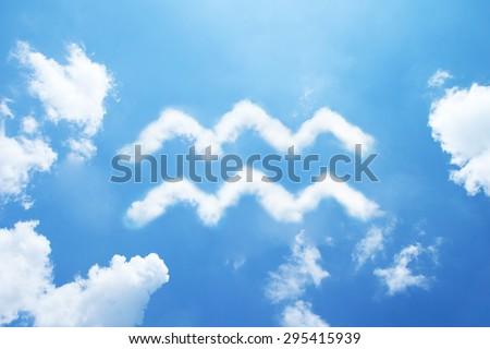Aquarius cloud zodiac sign on sky. - stock photo