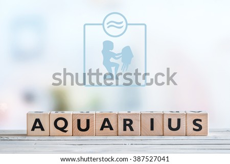Aquarius star sign on a wooden table - stock photo