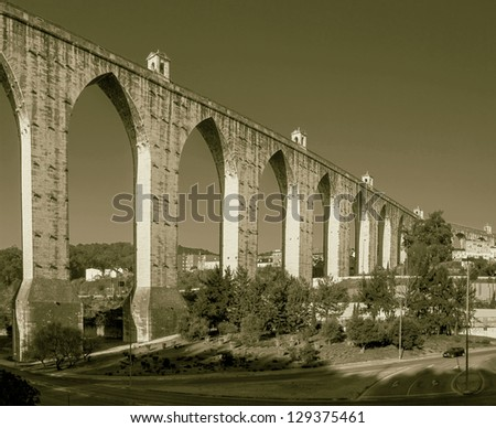Aqueduct in the Lisbon built in 18th century, Portugal (stylized retro) - stock photo