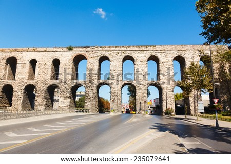 Aqueduct of Valens on background blue sky in Istanbul, Turkey. - stock photo