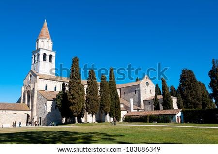 Aquileia Basilica and grassyard in italy - stock photo