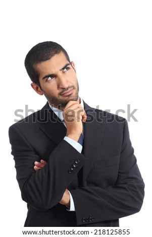 Arab business man thinking serious looking sideways isolated on a white background - stock photo