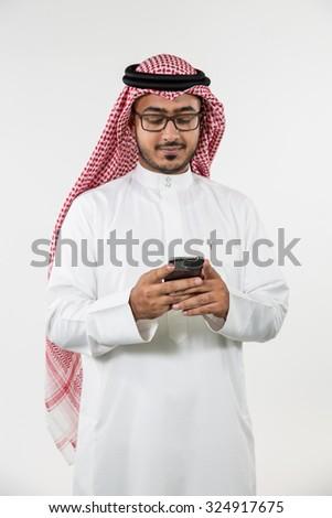 Arab businessman messaging on mobile - stock photo