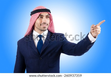 Arab businessman pressing virtual buttons - stock photo