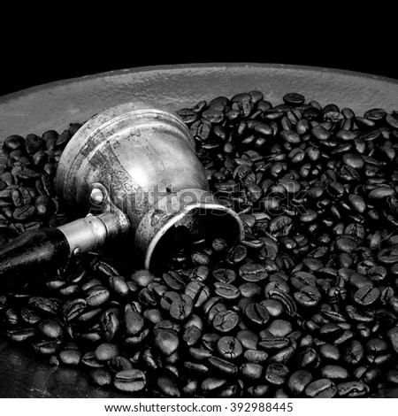 Arab coffee pot and roasted coffee beans - stock photo