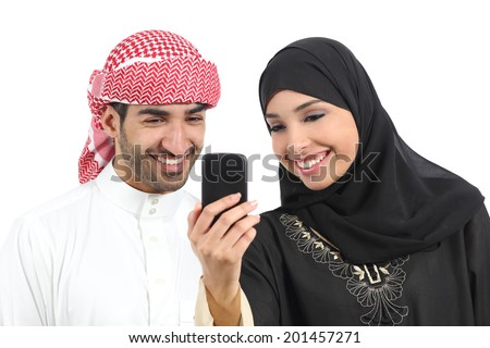 Arab couple sharing social media on the smart phone isolated on a white background             - stock photo