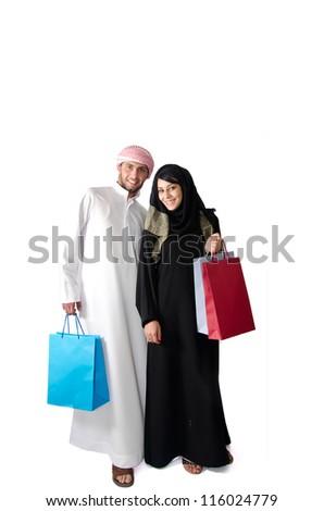 Arab couple shopping - stock photo
