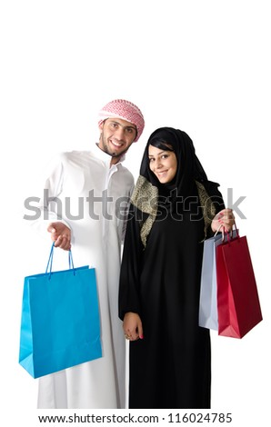 Arab couple shopping - stock photo