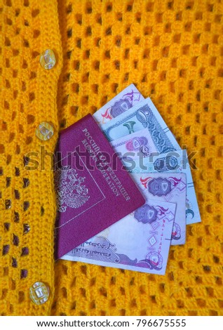 Arab dirhams and a Russian passport. The concept of travel.