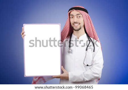 Arab doctor with blank message board