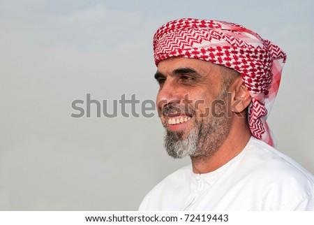 Arab Family in a public park - stock photo