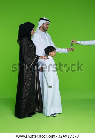 Arab family taking keys - stock photo