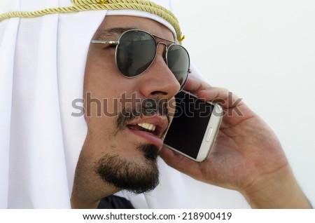 Arab man close up image calling with smart phone - stock photo