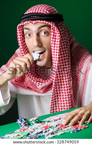 Arab man playing in the casino - stock photo