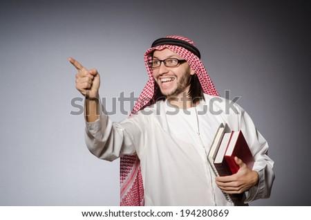 Arab man pressing virtual button - stock photo