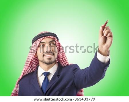 Arab man pressing virtual buttons - stock photo