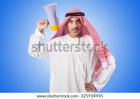 Arab man shouting through loudspeaker - stock photo