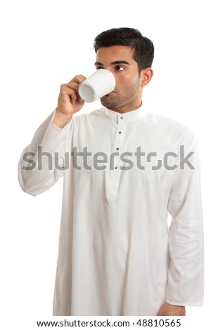 Arab middle eastern man drinks coffee. Arabica coffee is indigenous to the mountains of Yemen. The innovation in Yemen of making brew from roasted beans spread first to Egypt & later around the world. - stock photo