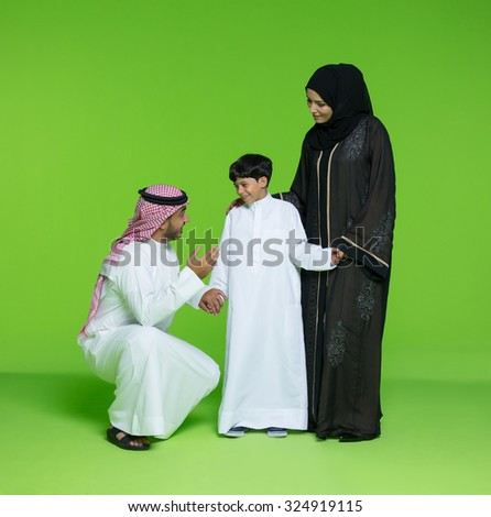 Arab parents with son - stock photo