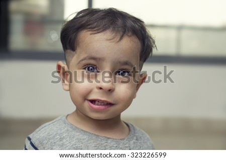Arab poor middle-eastern boy - stock photo