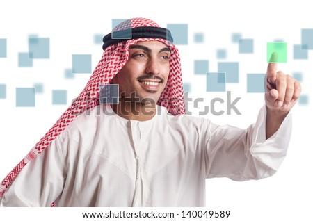 Arab pressing virtual buttons - stock photo