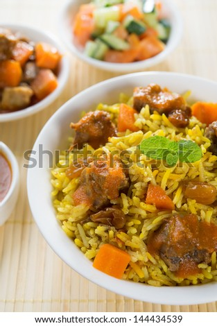 Arab rice, rice with meat and carrot in a bowl. Middle eastern food. - stock photo