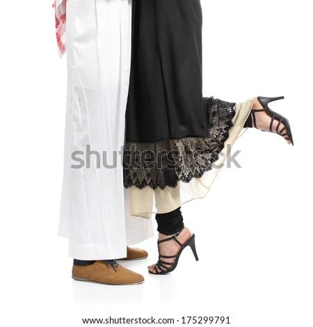 Arab saudi emirates couple legs hugging isolated on a white background            - stock photo