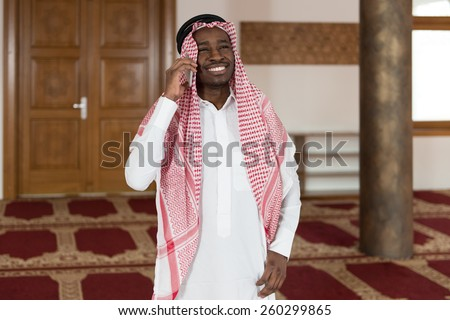 Arab Saudi Emirates Man Using A Smart Phone - stock photo