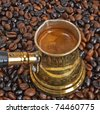 Arab small coffee pot on beans of coffee as background - stock photo