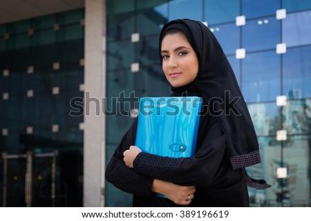 Arab Student holding a folder - stock photo
