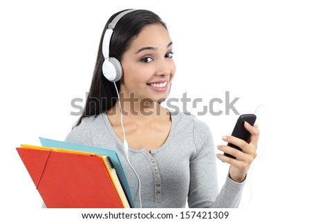 Arab student listening to the music and holding folders isolated on a white background             - stock photo