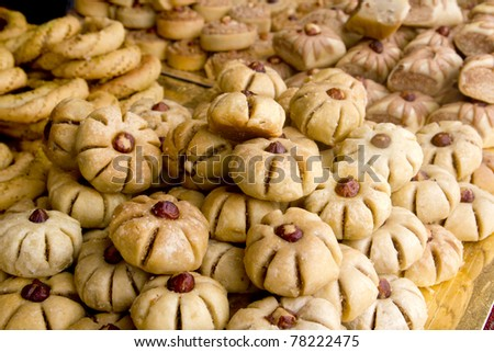 arab sweet pastries cakes stacked bakery with nuts - stock photo