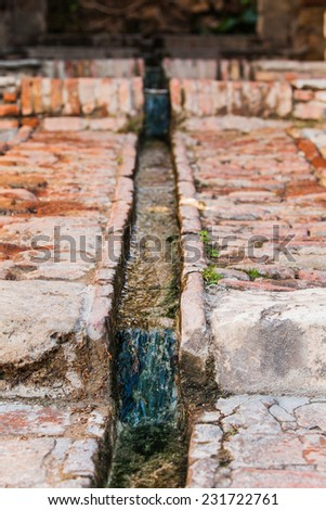 Arab water channel. - stock photo