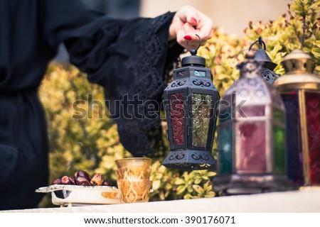 Arab woman in Abaya Holding Arabian Lantern - stock photo