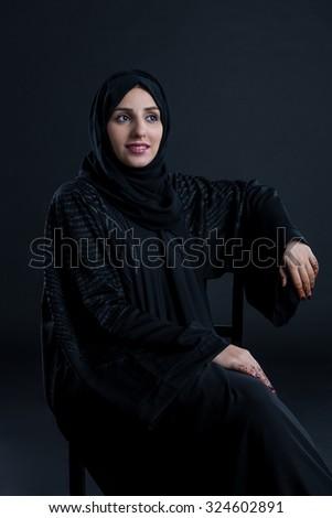Arab woman looking away - stock photo