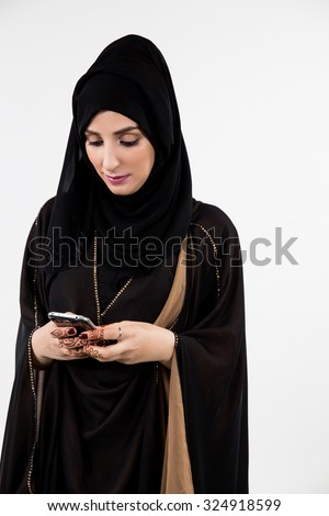 Arab woman messaging on mobile - stock photo