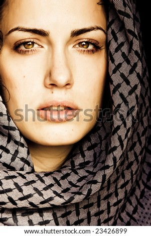 Arab woman using veil with her mouth pierced. - stock photo