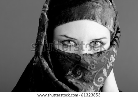 Arab woman wearing veil, black and white