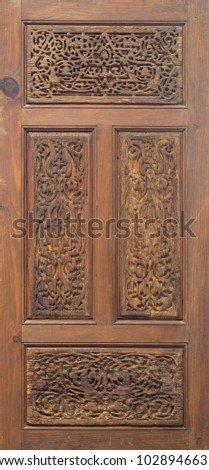 Arabesque floral engraved patterns of Fatimid style wooden ornate door leaf, Cairo, Egypt
