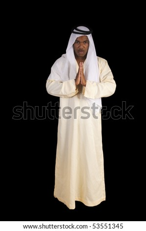Arabian african man in traditional dress over a black background - stock photo
