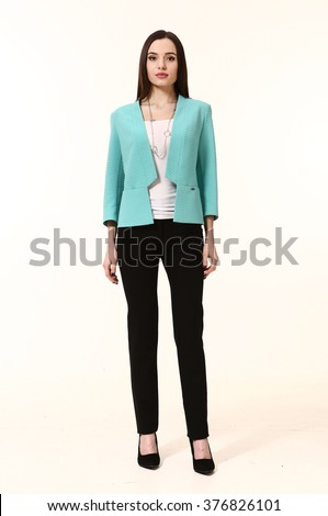 arabian asian eastern brunette business executive woman with straight hair style in blue jacket black trousers high heels shoes full length body portrait standing isolated on white - stock photo