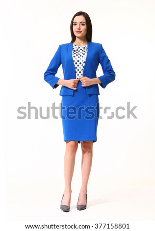 arabian asian eastern brunette business executive woman with straight hair style in blue skirt jacket two pieces suit  high heels shoes full length body portrait standing isolated on white - stock photo