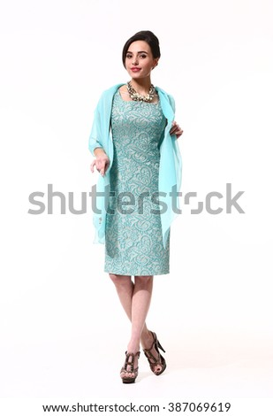 arabian asian eastern brunette business executive woman with straight hair style in formal blue cocktail party laces dress long sleeve dress high heel shoes standing full body length isolated on white - stock photo