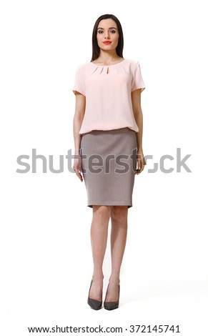 arabian asian eastern brunette business executive woman with straight hair style in pink t-shirt blouse and skirt suit high heels shoes full length body portrait standing isolated on white - stock photo