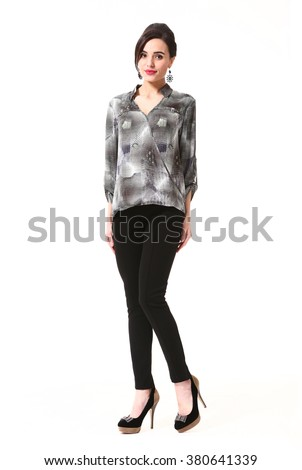 arabian asian eastern brunette business executive woman with up do hair style in office blouse and black trousers high heels shoes stand full body length isolated on white - stock photo