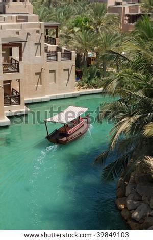 Arabian boat in the Jumairah chanel - stock photo