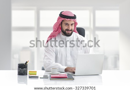 Arabian business man working on Laptop in the office - stock photo