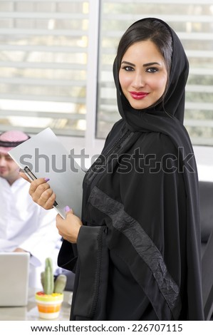 Arabian Businesswoman with her boss on Background  - stock photo